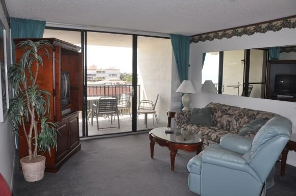 View of the living room of this top floor 1 bedroom / 2 full bath beach condo rental. Sleeper sofa in the living room makes this rental large enough for 4 guests. - Beach Condo Rental 511 - Cape Canaveral - rentals