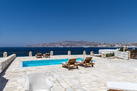 Waterfront Cleo offers dazzling Aegean Sea views, beach access & tranquil pool - Image 1 - Mykonos - rentals