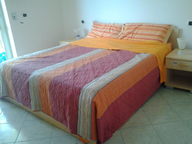 Master bedroom - low cost 2 bed beachfront apartment with Sea Views - Gizzeria Lido - rentals