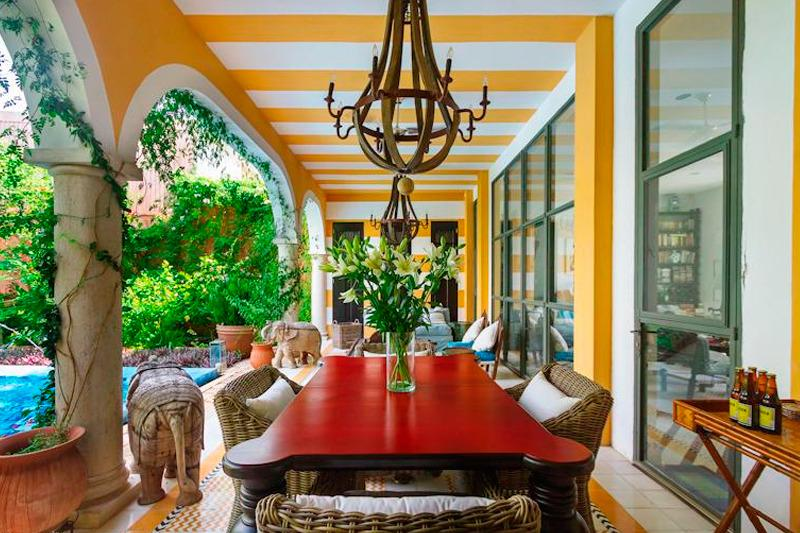 Dine al fresco in your colorful dining room alongside the shimmering pool - Luxe Style & Dazzling Garden Escape - Merida - rentals