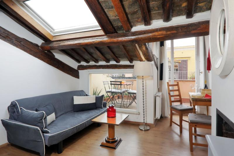 The large window allowing the sofa area to be surrounded by the greenery of the outside terrace, - ROME CENTER TREVI FOUNTAIN COZY APARTMENT WITH TERRACE WI FI/AC - Rome - rentals