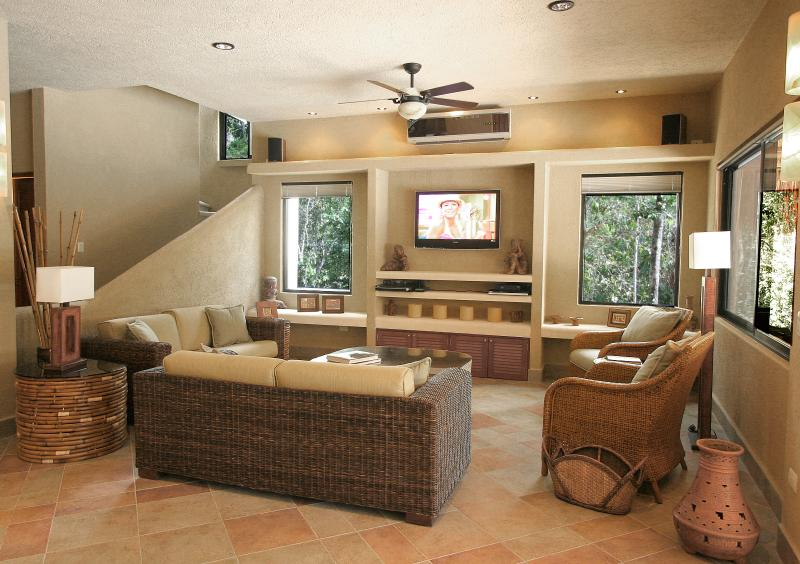 Sink into the comfortable wicker couches and enjoy HBO/Max on the 42 inch TV - 25% off April - August- Casa La Via - Luxury Villa - Akumal - rentals