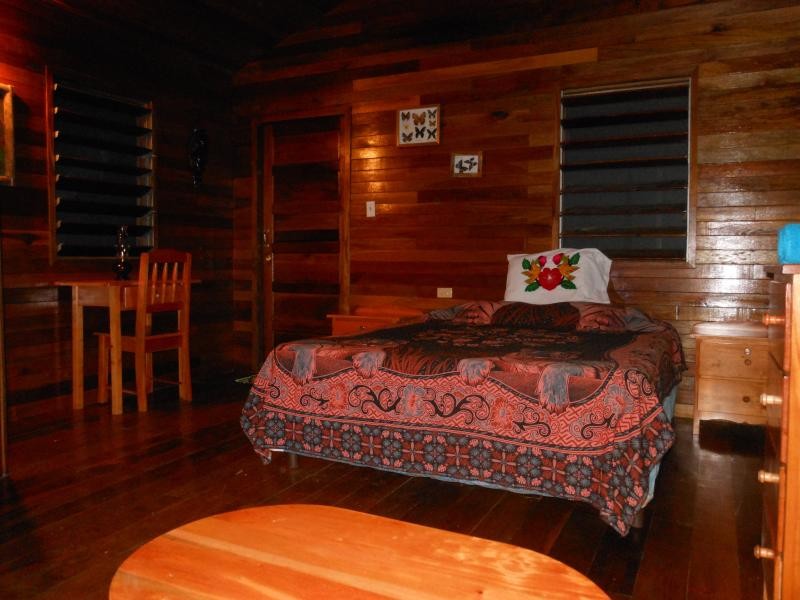 Interior of Toucan Cabana with high vaulted hardwood ceiling and floors, queen bed. - Macaw Bank Jungle Lodge - San Ignacio - rentals