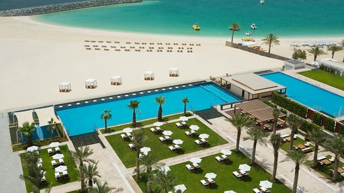 """Welcome to Dubai - View of Al Bateen pool area and private  beach and bar to the right "" - *Oceanfront Private Beach 5*, 4 BR ,  Apt , Sea Views ,  on JBR Walk ! - Dubai - rentals"