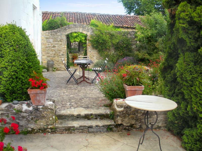 Large, character-filled house near Cognac with 4 bedrooms, colourful garden and terrace - Image 1 - Jarnac - rentals