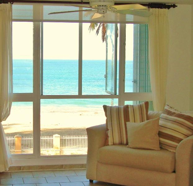 Living room with a Direct view to the White Sandy Beach - Real Beach Front Penthouse 15 m from SJU airport - Loiza - rentals