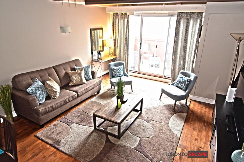Beautiful large open living area with modern furniture - sofa bed - Luxurious 2 Floor Loft - Fashion Dist - King St. W - Toronto - rentals