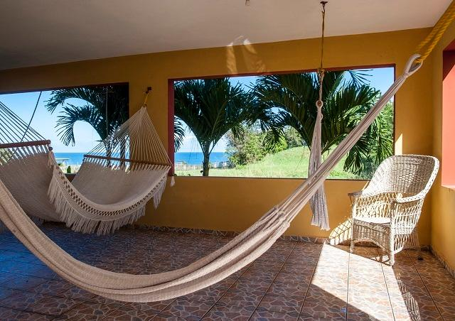 Plenty of space to relax, unwind and enjoy the ocean breeze on our hammocks. - Ocean View / West Coast (Sleeps 1-13) - Camuy - rentals