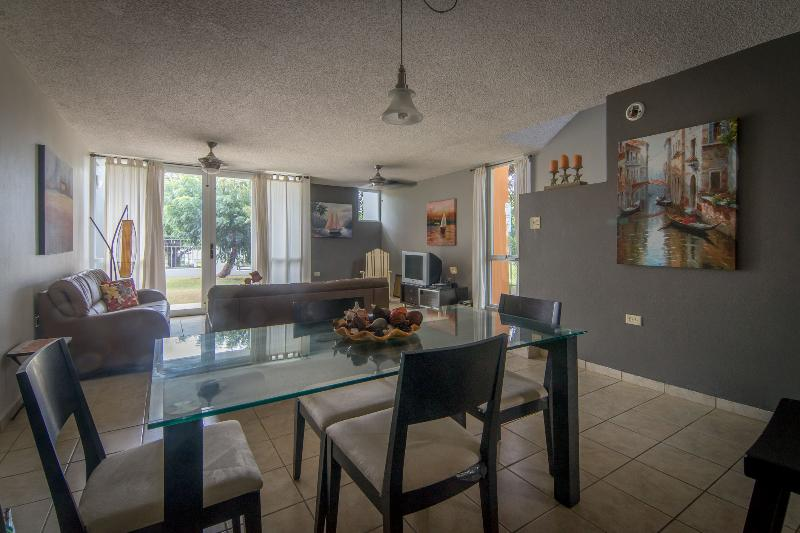 Living area with direct access to the rear patio. - Corner unit townhouse in Camino del Mar w/ wifi - Cabo Rojo - rentals