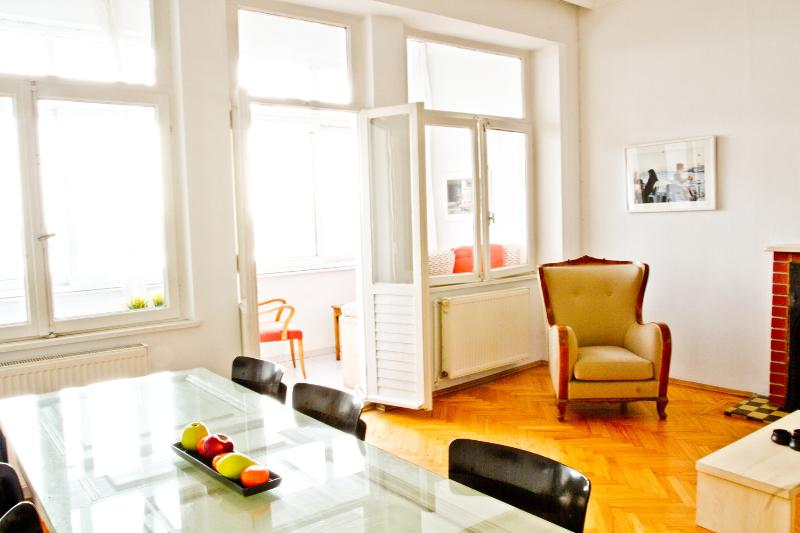 Spacious living room w/ dining table and entrance to balcony with the view over Golden Horn - Breathtaking Golden Horn view- Living Istanbul - Istanbul - rentals