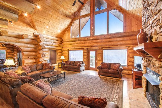 Soaring ceiling, wall of windows and stackedstone fireplace greet you upon arrival at Grand View - Grand View Lodge ~ 6 King Master Suites!!! Game Rm, Mountain View, Pool Access, - Gatlinburg - rentals