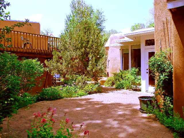 Lovely landscaping between guest house on left and main house on right - Juniper Springs Main House and Guest house - Taos - rentals