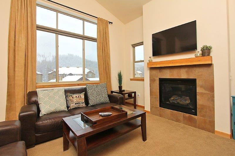 Cozy up to the fireplace or catch up on your favorite shows with the flat screen tv - Trailhead Lodges 831 - Winter Park - rentals