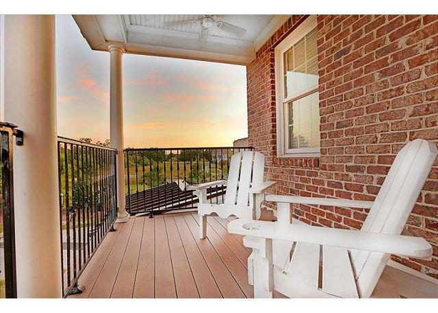 View of the sunset from the master suite balcony - Plantation style home on beautiful Hutchinson Island - Savannah - rentals