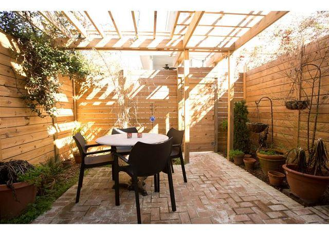 Private brick patio with pergola - Modern amenities in a historic 2 bedroom home - Savannah - rentals