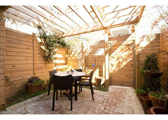 Patio off Living area - Modern amenities in a historic 2 bedroom home - Savannah - rentals