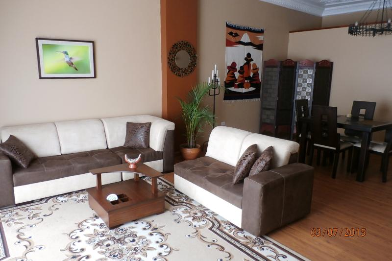 Living room and dining area - Grand Colonial in the Heart of Cuenca - Cuenca - rentals