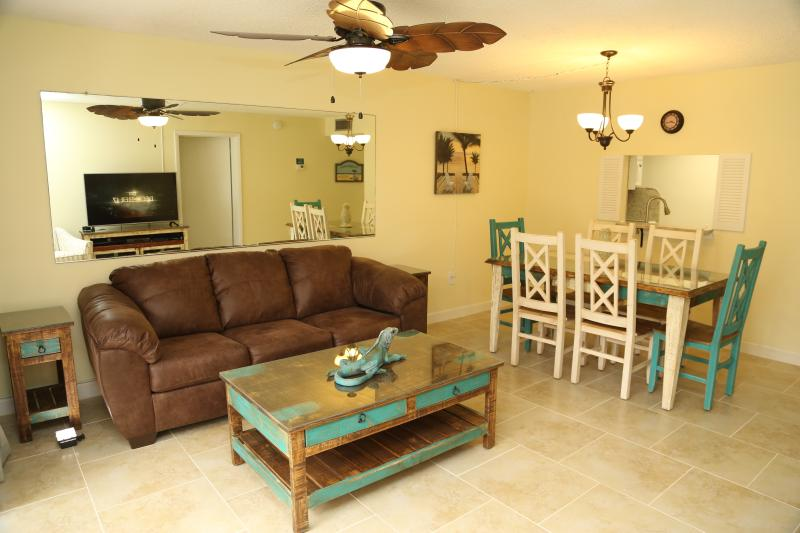 Living room with Queen sofa sleeper - Right on the Ocean - Ground Floor - Next to Pier - Cocoa Beach - rentals