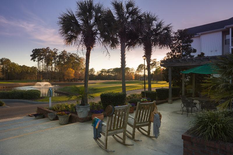 On green, indoor/outdoor pool, screened porch - Image 1 - Murrells Inlet - rentals