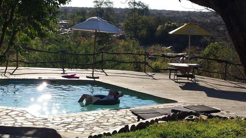 View from kitchen onto pool deck - Little Carthage Hoedspruit - Hoedspruit - rentals