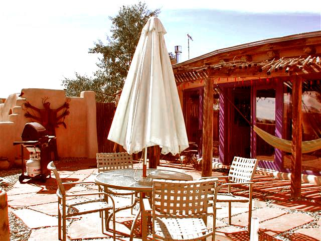 Shaded portal (Spanish for covered patio) with hammock + umbrella patio dining - Adobe de Eototo - Taos - rentals