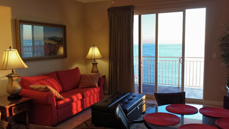 Living room with balcony, queen sofa-bed, twin ottoman-sleeper, and new 46in TV - Oceanfront 2BR/2BA/8ppl  Condo - Low Floor - Panama City Beach - rentals