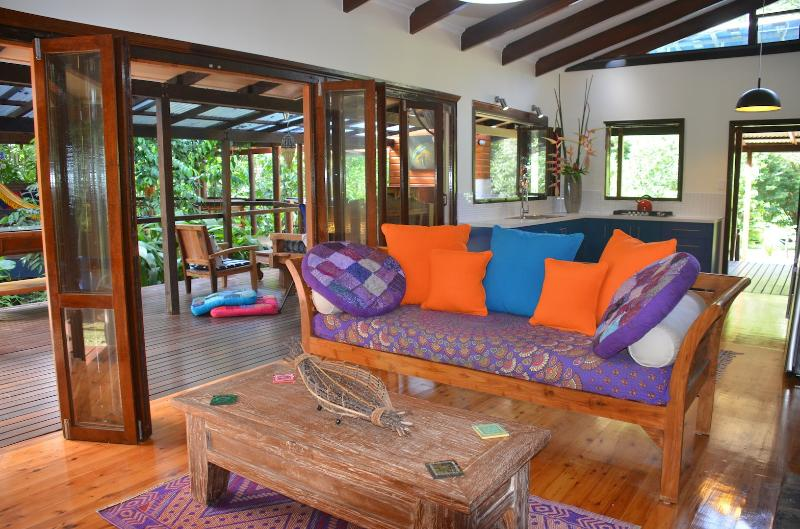 Open plan lounge and kitchen connect to large verandahs overlooking the rainforest and orchard - Wildwood house in organic orchard in Cape Tribulat - Cape Tribulation - rentals