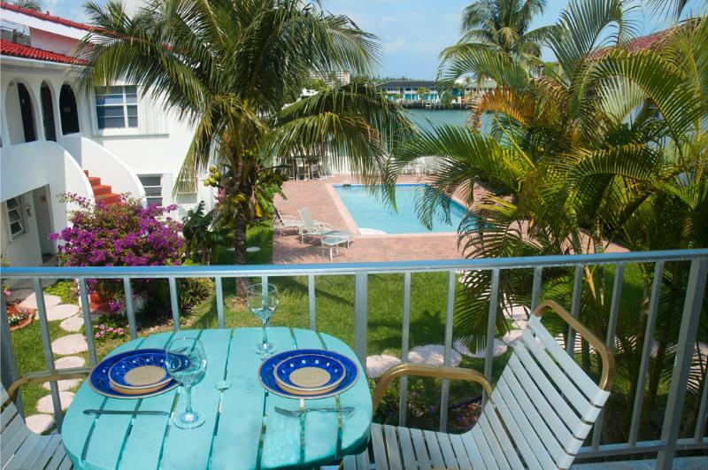 The balcony has an amazing view over the pool and the water beyond. - Lovely One-bed waterfront Condo near Beach & shops - Freeport - rentals