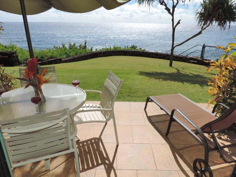 Picture yourselves... you will be enjoying yourself gazing at the Blue Pacific? - Poipu Shores 104C, 2BR OCEANFRONT LRG Townhome. 2 oceanfront lanai, heated pool - Poipu - rentals
