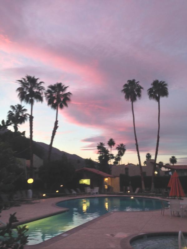 Typical sunset view from large pool just steps from the front door. - Palm Springs Estados South Ground Floor Condo - Palm Springs - rentals