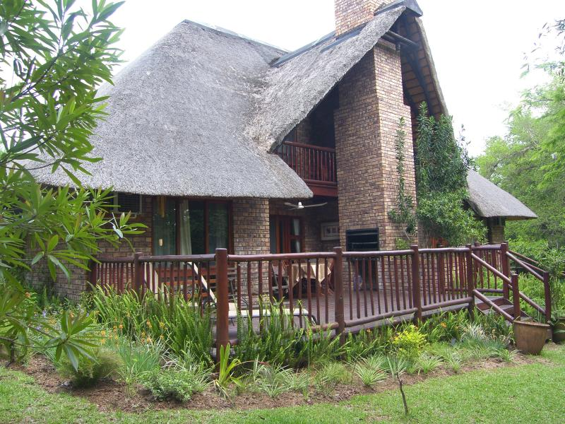 Chalet with large decked patio as seen from the wooded garden - Kruger Park Lodge, chalet Shongwe Ingwe, Hazyview - Hazyview - rentals