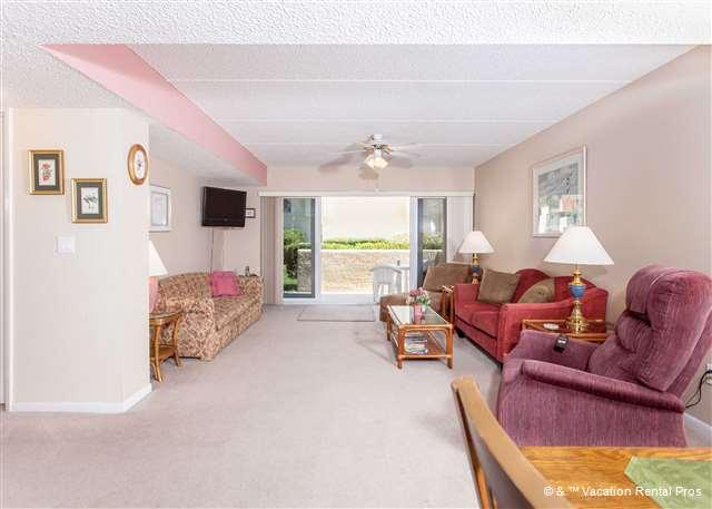 The living room is light, spacious, and sun-filled! - Pier Point 37, Ocean Views & Pool at St Augustine Beach Pi - Saint Augustine - rentals
