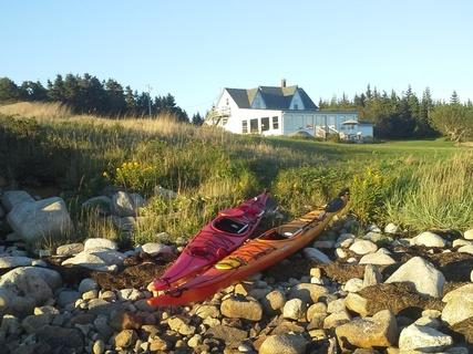 Kayaks waiting along the shore - Ocean's Playgound Cottage - Bear Point - rentals