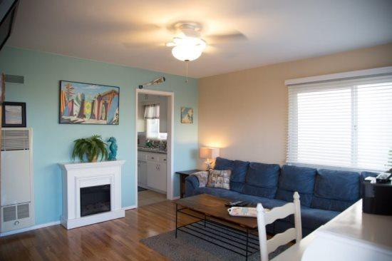 Large couch with electric fireplace - Beach-N-Bay 1 Bedroom - Pacific Beach - rentals