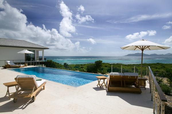 With its own secluded beach cove and views towards St. Martin, this villa is dramatically nestled in the rolling landscape. RIC KAM2 - Image 1 - Anguilla - rentals