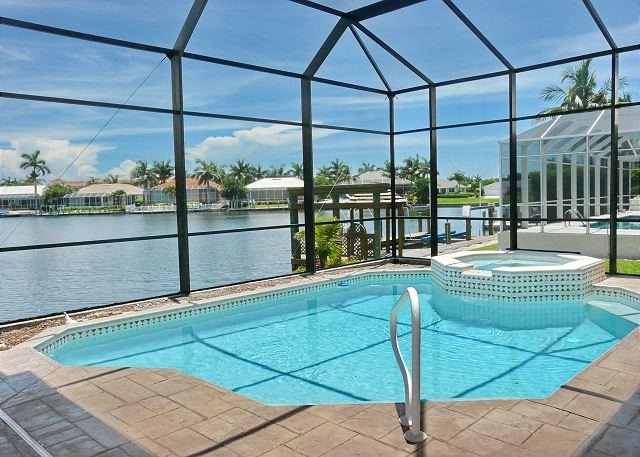 Stylish, waterfront house w/ everything from a pool table to a heated pool - Image 1 - Marco Island - rentals