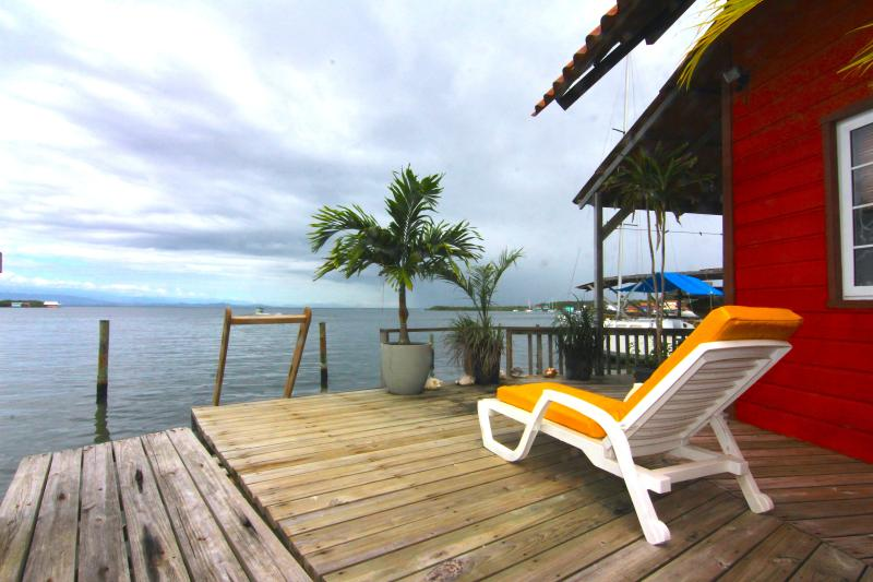 terrace and dock with view of saigon bay - OVER THE WATER RENTALS - footsteps from the beach - Bocas del Toro - rentals