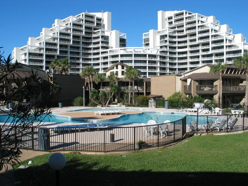 Our Signature high rise Resort as seen from the second swimming pool. - Comfortable, Convenient, Economical & on the Beach - South Padre Island - rentals