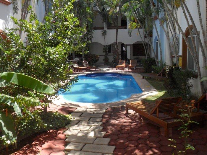 Pool area within the atrium, perfect for quiet relaxation and reflection. - Chic Apartment, Great Location, Pool, Secure - Playa del Carmen - rentals