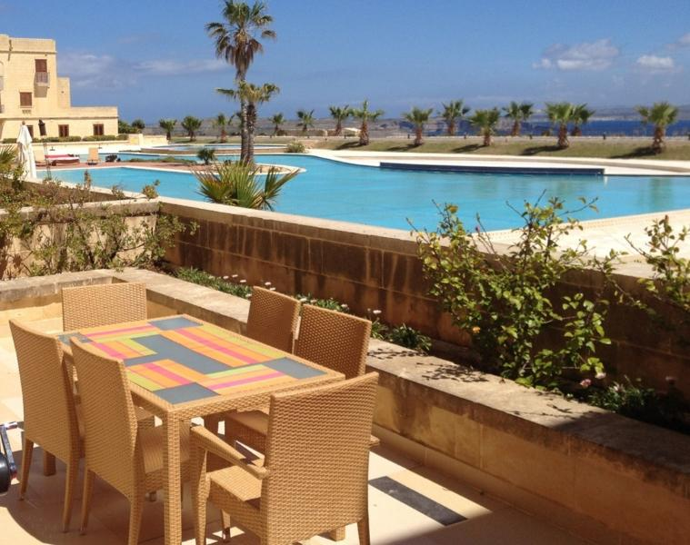 Extensive private terrace with spectacular views of pool and Mediterranean Sea - Fort Chambray Apartment with Pool And Sea View - Ghajnsielem - rentals