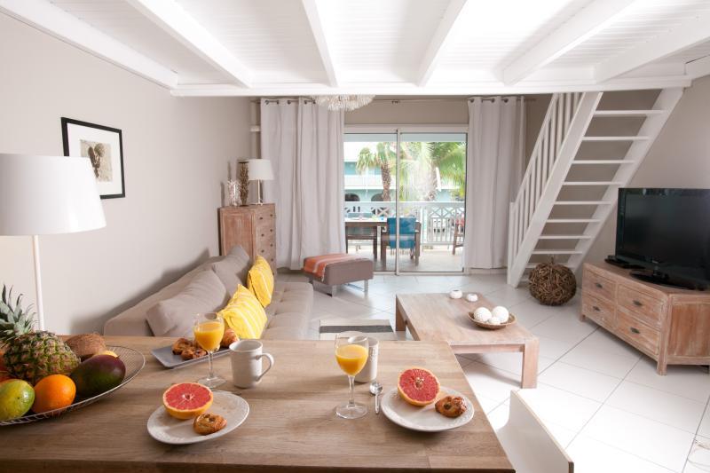 STAY 7 NIGHTS SAVE 1 NIGHT FREE- BEACHFRONT CONDO - Image 1 - Orient Bay - rentals