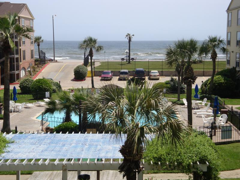 Private balcony overlooks winter heated pool - Views of Beach, Gulf Waters and Waterfall Pool - Galveston - rentals