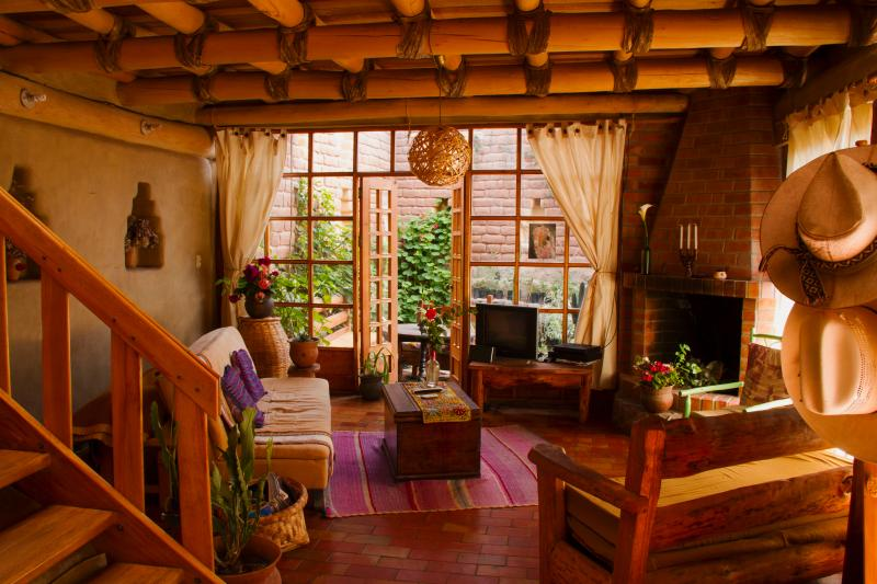 Beautiful spacious living room with Chimney - Cusco Vacation Rentals Valley And Life Cottages - Cusco - rentals