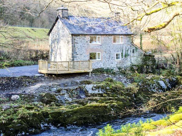 PEN Y BONT, pet-friendly riverside cottage, beams, woodburner, ideal touring base, Mallwyd Ref 25712 - Image 1 - North Wales - rentals