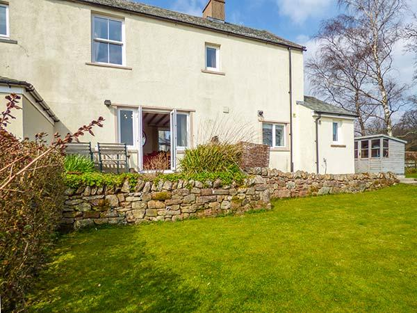 STAG COTTAGE, sandstone fronted, woodburning stove, off road parking, garden - Image 1 - Penruddock - rentals