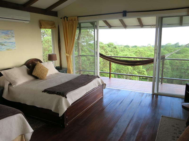 Room 1 with panoramic views over forest to the ocean - SEMILLA VERDE LODGE - Puerto Ayora - rentals