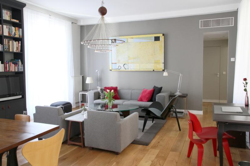 Bright, airy living room with Cappellini and other designer chairs.  Separate air-conditioning. - Luxury Apt Le Marais, A/C, highly rated, quiet - Paris - rentals