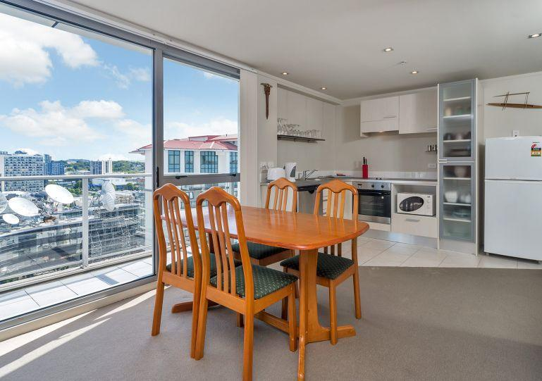 Living area overlooks the city - H47 City View One Bedroom Apartment with Balcony in Auckland CBD, NZ - Auckland - rentals