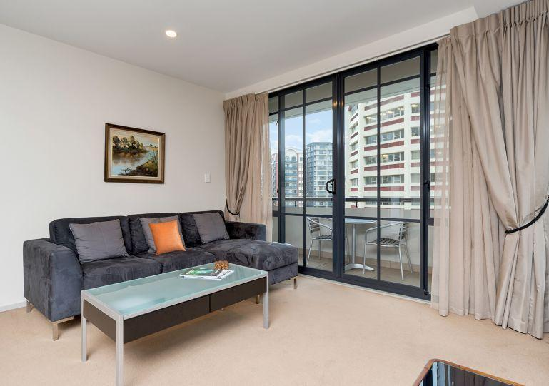 Lounge opens out onto the balcony - 2nd floor corner apartment in the Connaught Building, Auckland - Albany - rentals