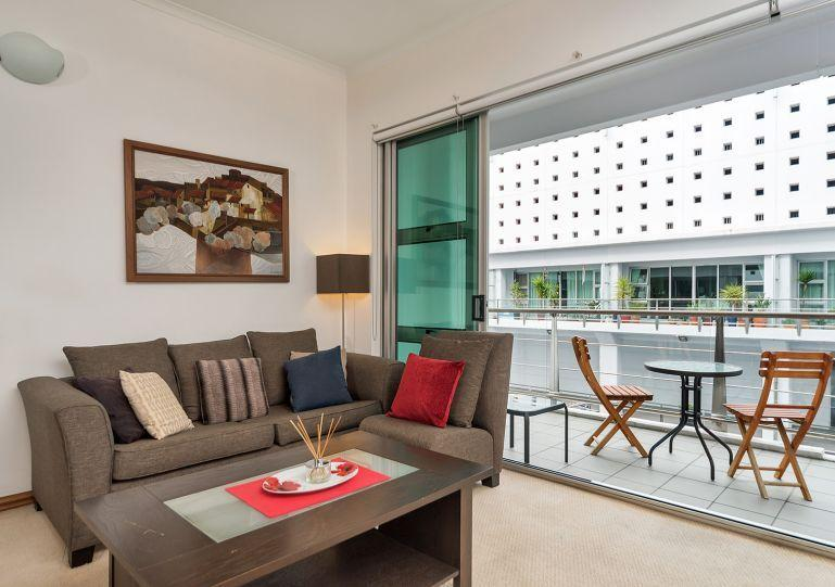 Living area opens out onto the balcony - Street Side Princes Wharf One Bedroom Apartment Shed 23 - Auckland - rentals